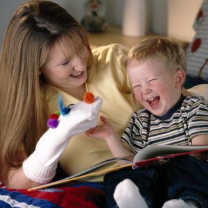 A mom makibg a sock puppet and making child laugh