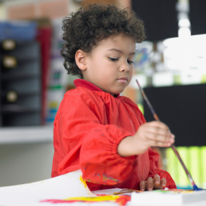 Child painting at school